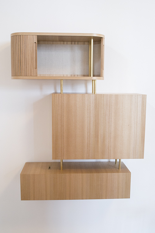 The cabinet combines both straight and round shapes.